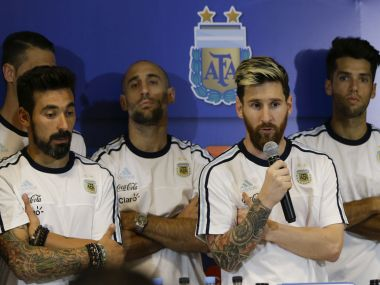 Lionel Messi talks to the press surrounded by the teammates after their match. AP