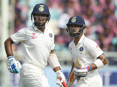 Cheteshwar Pujara and Virat Kohli steadied India's innings after losing both the openers early. AP