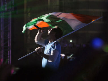 Chris Martin performs with the Indian flag at the Global Citizen Festival India. Sachin Gokhale/Firstpost