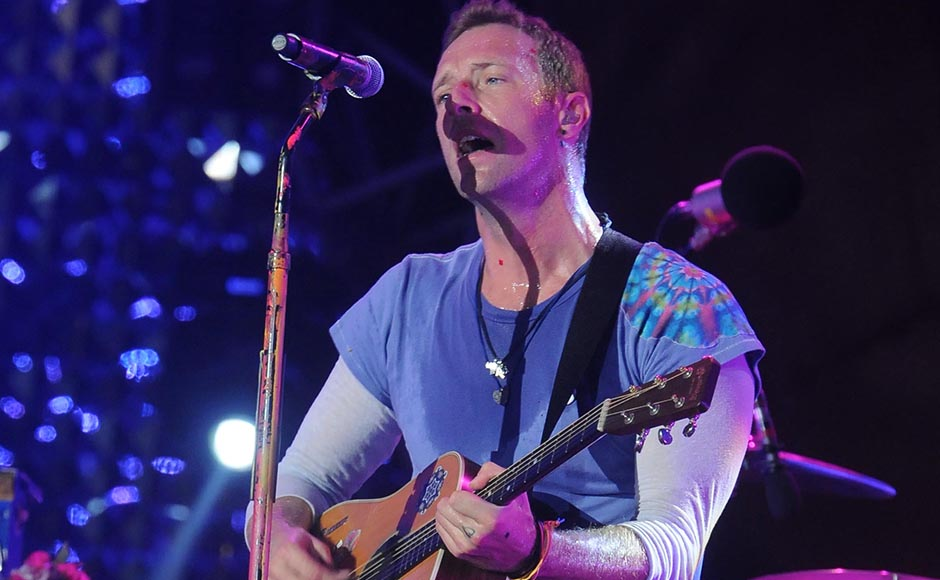 Chris Martin of Coldplay performs at the Global Citizen Festival at MMRDA ground Mumbai, India, Saturday. Sachin Gokhale/Firstpost