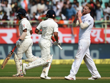England's Ben Stokes (R) reacts to being hit away. AFP