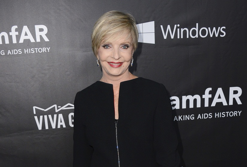 "In this October, 2014 file photo, Florence Henderson arrives at the 2014 amfAR Inspiration Gala at Milk Studios in Los Angeles. Henderson, the wholesome actress who went from Broadway star to television icon when she became Carol Brady, the ever-cheerful mom residing over ""The Brady Bunch,"" has died at age 82. She died surrounded by family and friends, her manager, Kayla Pressman, said in a statement late Thursday, Nov. 24, 2016. (Photo by Jordan Strauss/Invision/AP, File)"