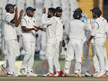 Indians celebrate the dismissal of England's Jos Buttler on Day 1 of 3rd Test match in Mohali. AP