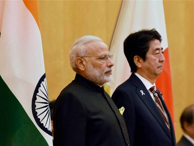 Prime Minister Narendra Modi with Japanese Prime Minister Shinzo Abe during his ceremonial welcome in Tokyo on Friday. PTI