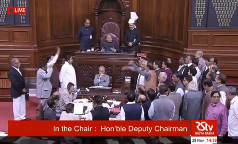 Opposition parties troop down to the Well demanding Prime Minister Modi's presence. YouTube screengrab.