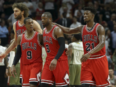 Dwyane Wade (C) with his Chicago teammates Rajon Rondo (L) and Jimi Butler (R). AFP