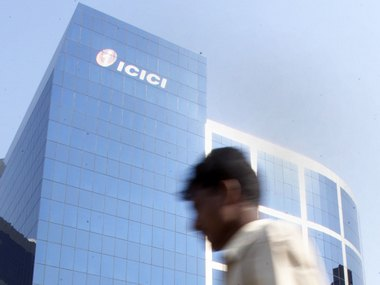 A man walks past the ICICI's headquarter's in Bombay October 25, 2001. ICICI Ltd, the leading Indian financial services company and ICICI Bank, country's largest private bank annouced on Thursday they are merging, creating the nation's first universal bank, or one-stop provider of all types of financial services. REUTERS/Arko Datta AD/AA