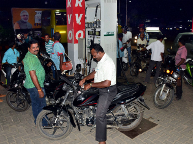 People crowd at a petrol pump to fill petrol as the Prime minister ordered to ban 500 and 1000 rupees notes. PTI