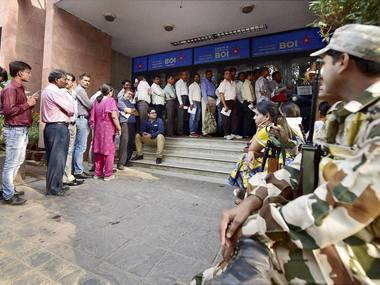 People queue up to change their old currency notes outside Bank of India in New Delhi on Thursday. PTI Photo(PTI11_10_2016_000315B)