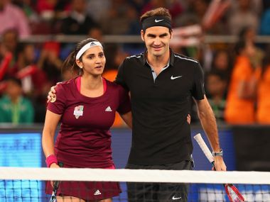 Roger Federer and Sania Mirza of the Indian Aces during IPTL 2014. Getty
