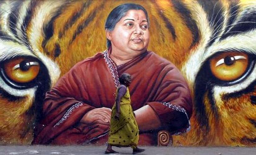 A woman walks in front of a portrait of Jayalalithaa, a former film actress and now head of the state opposition party, the All India Anna Dravida Munnetra Kazhagam (AIADMK), in the southern Indian city of Chennai March 2, 2009. India will hold a general election between April 16 and May 13, election officials said on Monday, kicking off a mammoth process in which 714 million people will be able to cast their votes. Reuters