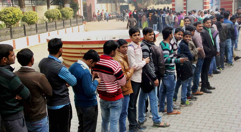 Allahabad : People standing in a long queue to withdraw cash from an ATM in Allahabad on Tuesday. PTI Photo (PTI12_13_2016_000084B)