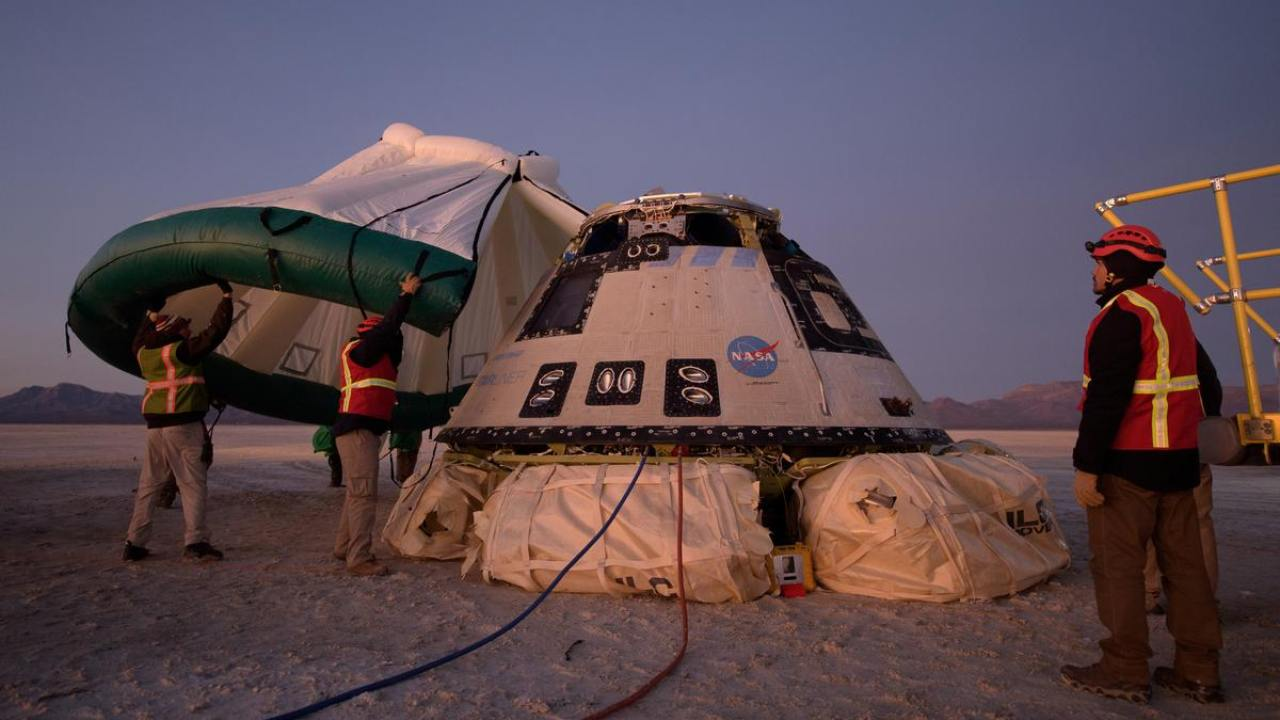 A protective tent is used to cover the Boeing CST-100 Starliner after its descent by parachute following an Orbital Flight Test for NASA's Commercial Crew programs. Image: NASA