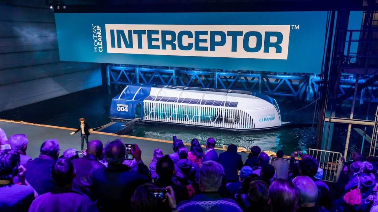 Byan Slat, founder of the Ocean Cleanup, introduces the Interceptor during its unveiling event on Oct. 26, 2019, in Rotterdam, The Netherlands. Image courtesy of The Ocean Cleanup.