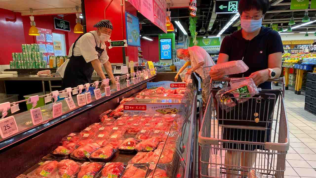 A resident wearing a face mask to curb the spread of the coronavirus browses meat products at a supermarket in Beijing, Monday, June 15, 2020. China's capital was bracing Monday for a resurgence of the coronavirus after more than 100 new cases were reported in recent days in a city that hadn't seen a case of local transmission in more than a month. AP