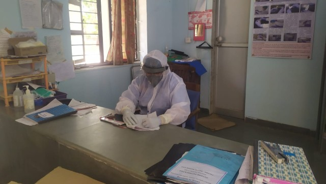 Working through patient records dressed in a PPE suit. Image courtesy: Dr Nahush Chafekar