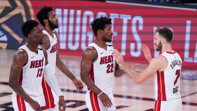 Miami Heat's Bam Adebayo (13), Derrick Jones Jr., left rear, Jimmy Butler (22) and Goran Dragic (7) celebate after their NBA conference final playoff basketball game against the Boston Celtics on Thursday, Sept. 17, 2020, in Lake Buena Vista, Fla. (AP Photo/Mark J. Terrill)