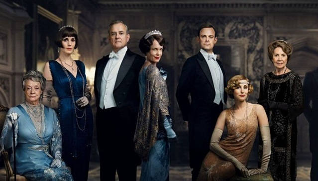 In the Downton Abbey movie, the Crawleys play host to the King and Queen. Image via Twitter