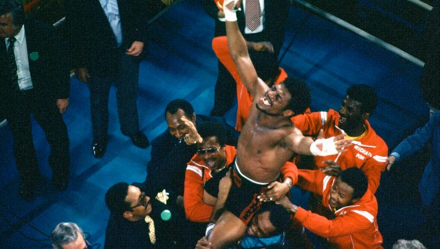 Leon Spinks with his entourage holding him aloft, celebrates his 15-round split decision victory over world heavyweight boxing champion Muhammad Ali in Las Vegas. AP