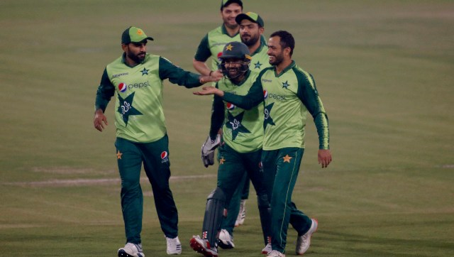 Pakistan's Mohammad Nawaz, right, celebrates with teammates after taking the wicket of South Africa's Janneman Malan, center, during the 3rd Twenty20 cricket match between Pakistan and South Africa at the Gaddafi Stadium, in Lahore, Pakistan, Sunday, Feb. 14, 2021. (AP Photo/K.M. Chaudary)