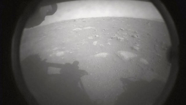 A still image made from video provided by NASA, shows an image sent by the Perseverance rover, showing the surface of Mars, just after landing on Thursday. NASA via The New York Times