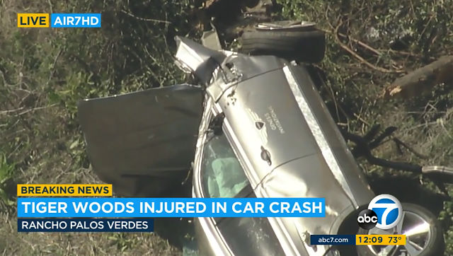 An aerial image taken from video provided by KABC-TV, a vehicle rests on its side after a rollover accident involving golfer Tiger Woods along a road in the Rancho Palos Verdes section of Los Angeles on Tuesday. KABC-TV via AP