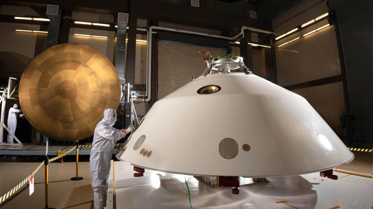 Pictured are the Mars 2020 backshell heat shield (foreground) and the main PICA heat shield (background).  Image credit: NASA/JPL-Caltech